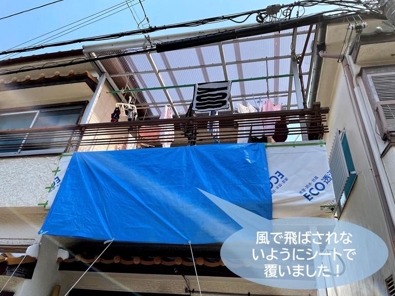 和泉市のベランダの外壁をシートで養生