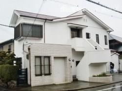 岸和田市上松町のアーバントーンが映える外壁塗装の現況
