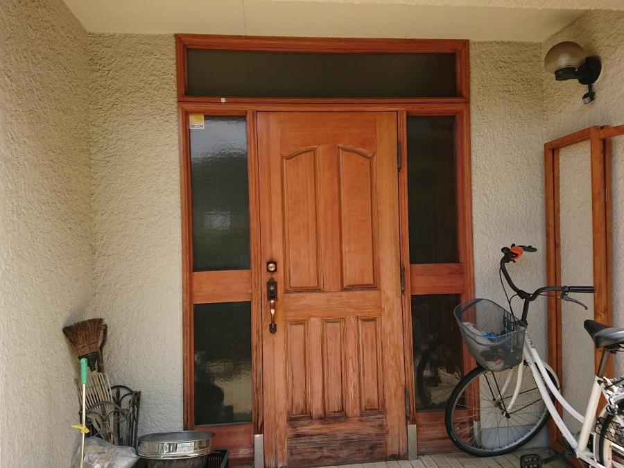 和泉市の傷んだ玄関ドア