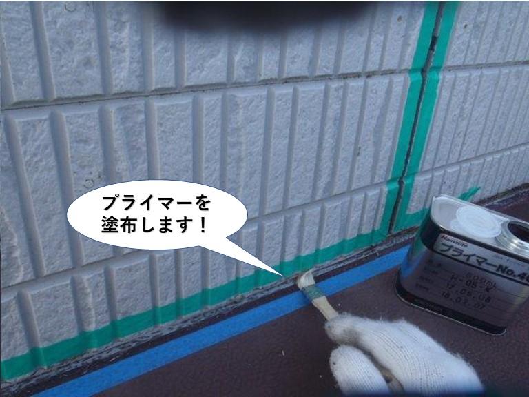 岸和田市の庇の上にプライマーを塗布